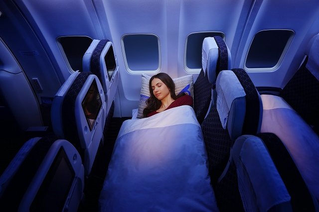 sleeping in economy class