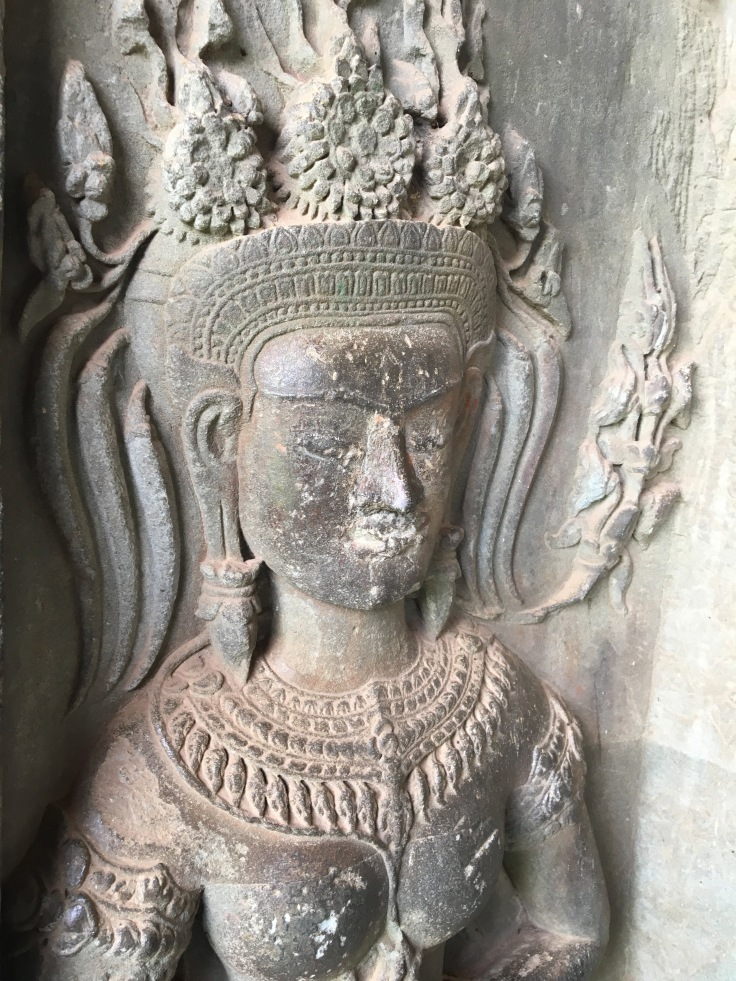 siem reap angkor wat stone carving religious figure