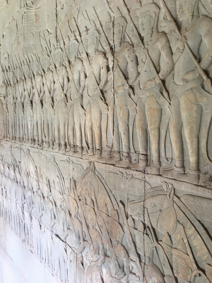 siem reap angkor wat temple battle stone carving