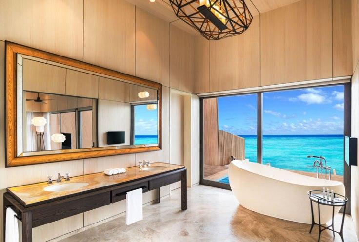 st regis maldives hotel overwater suite bathroom promo