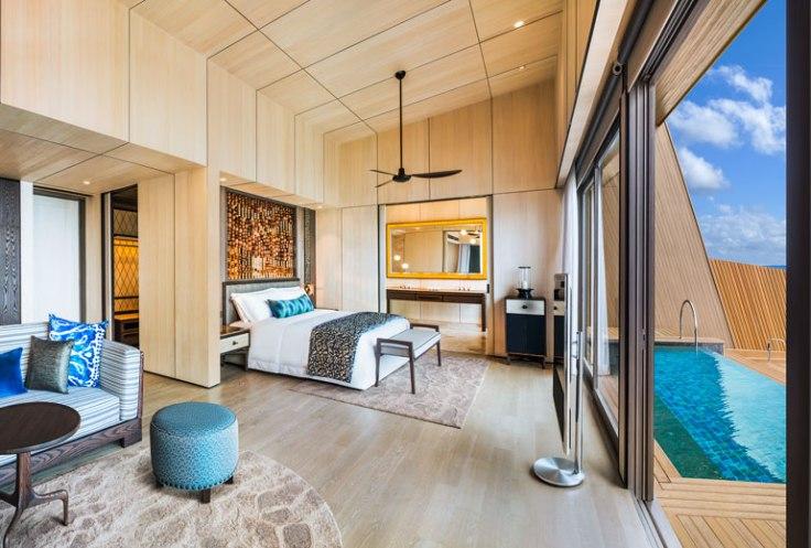 st regis maldives hotel overwater suite bedroom promo.jpg