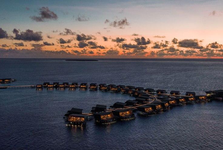 st regis maldives hotel overwater suite promo.jpg