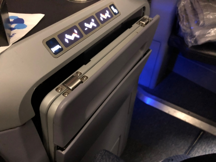 united airlines polaris business diamond hard seat tray table partial
