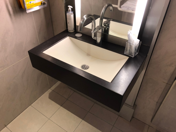 air france business salon cdg shower sink basin