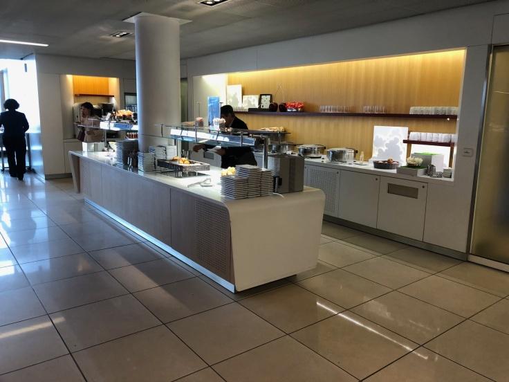 air france business salon cdg window side food table