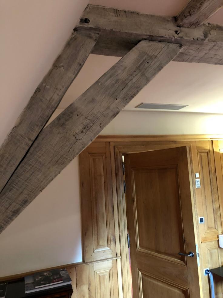 l'hermitage gantois lille room wooden rafters