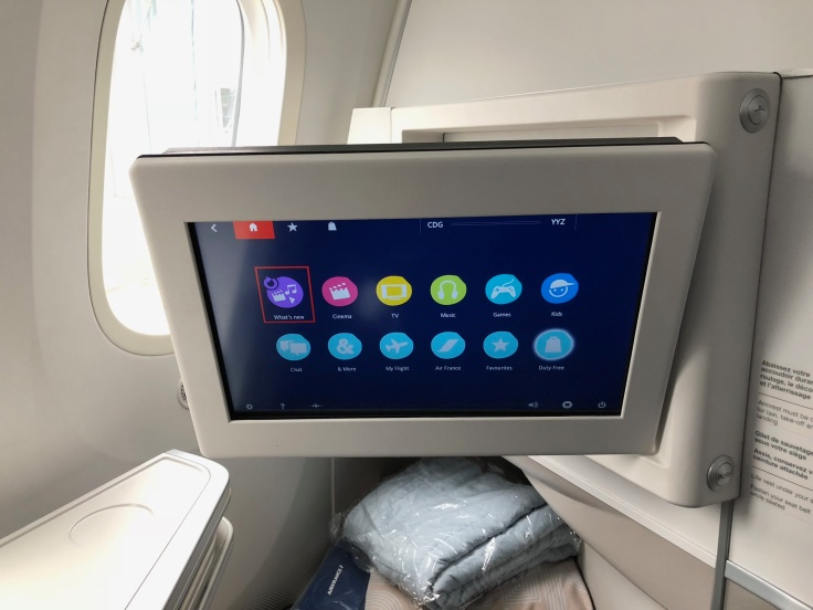 air france business hard seat entertainment system facing downward