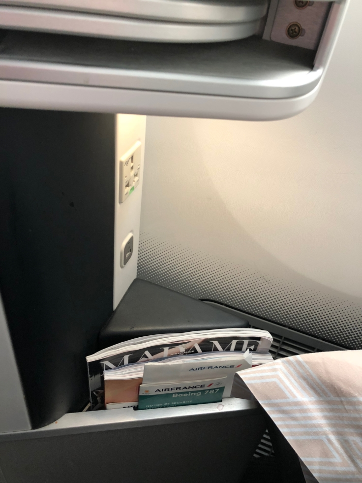 air france business hard seat power and literature nook