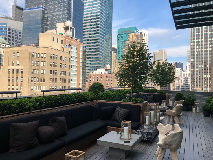 ac hotel new york times square public lounge terrace reverse angle