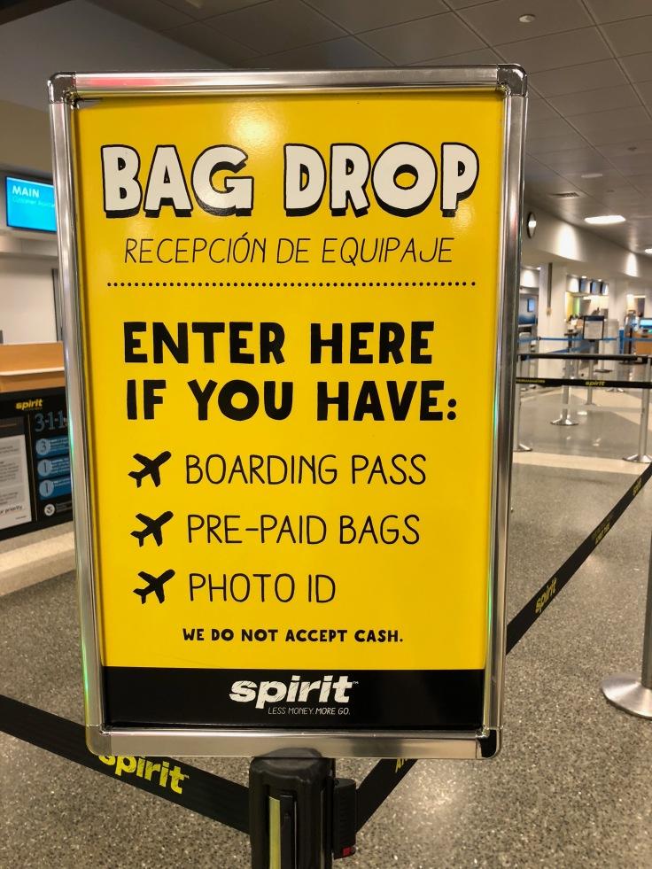spirit airlines airport bag drop sign