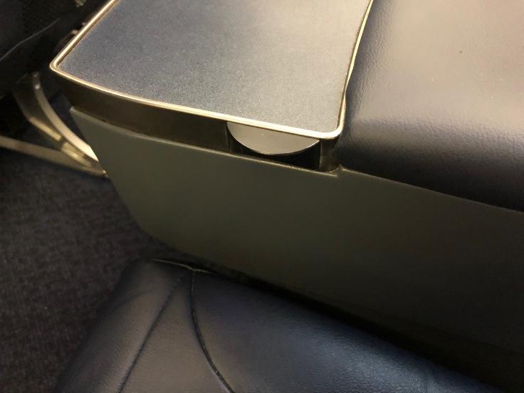 spirit airlines hard big front seat armrest inside