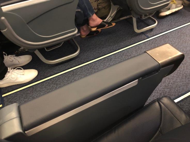 spirit airlines hard big front seat armrest outside