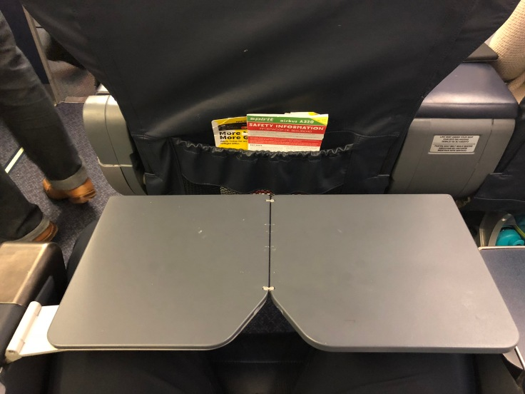 spirit airlines hard big front seat tray table extended