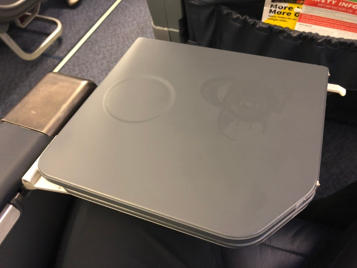 spirit airlines hard big front seat tray table folded