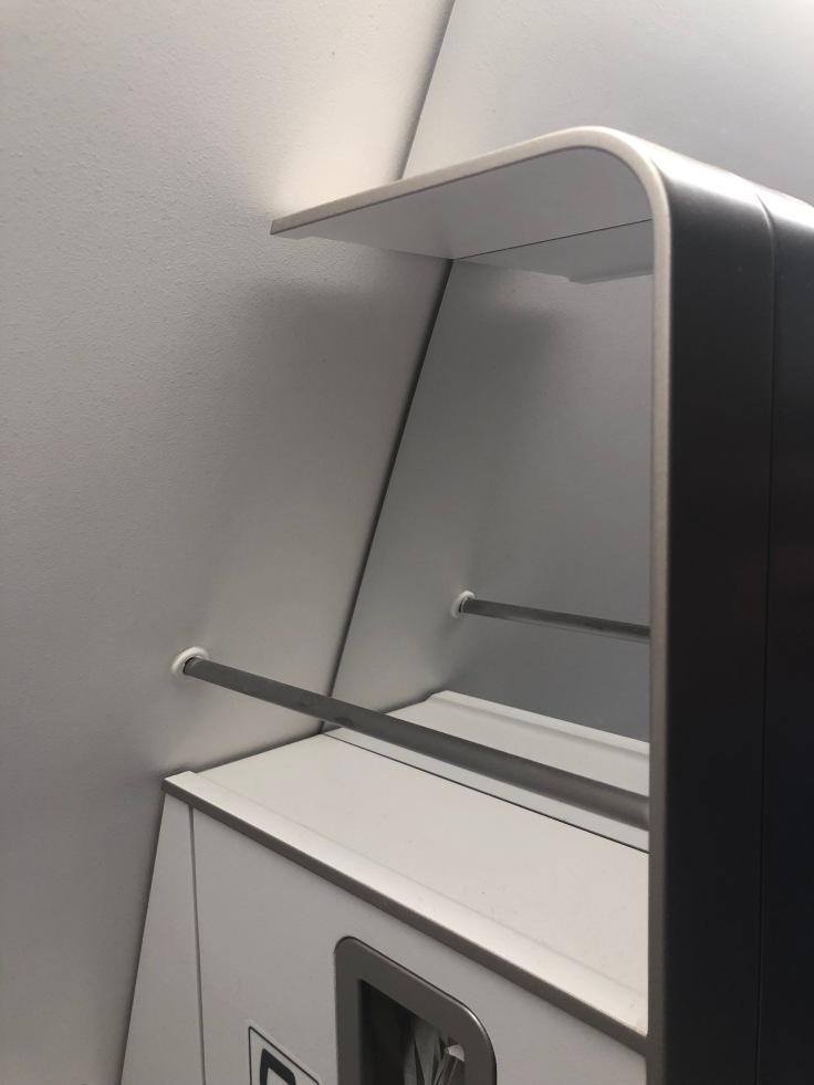 2019 iberia premium economy 07 lavatory 1 storage area